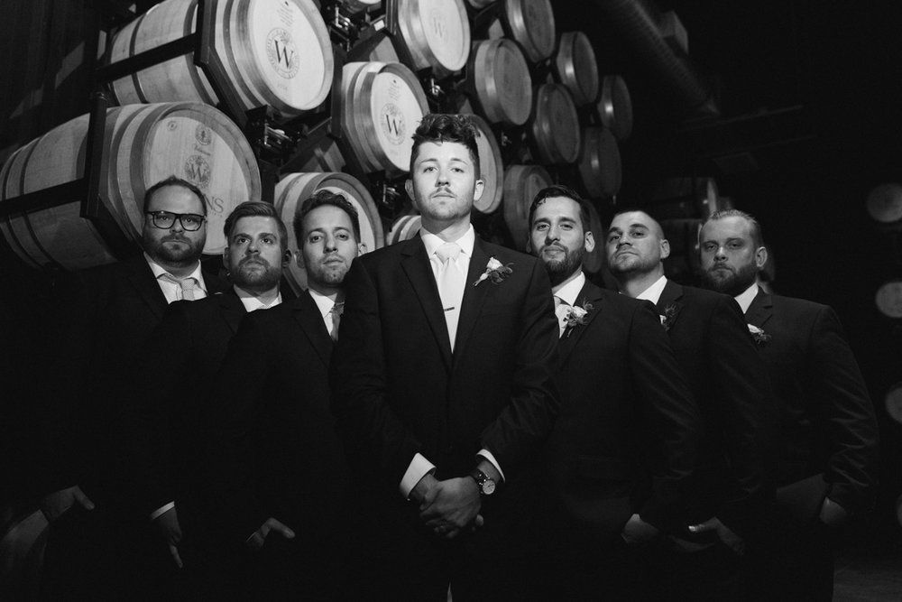 Groomsmen in barrel room at Temecula winery, Wiens Family Cellars