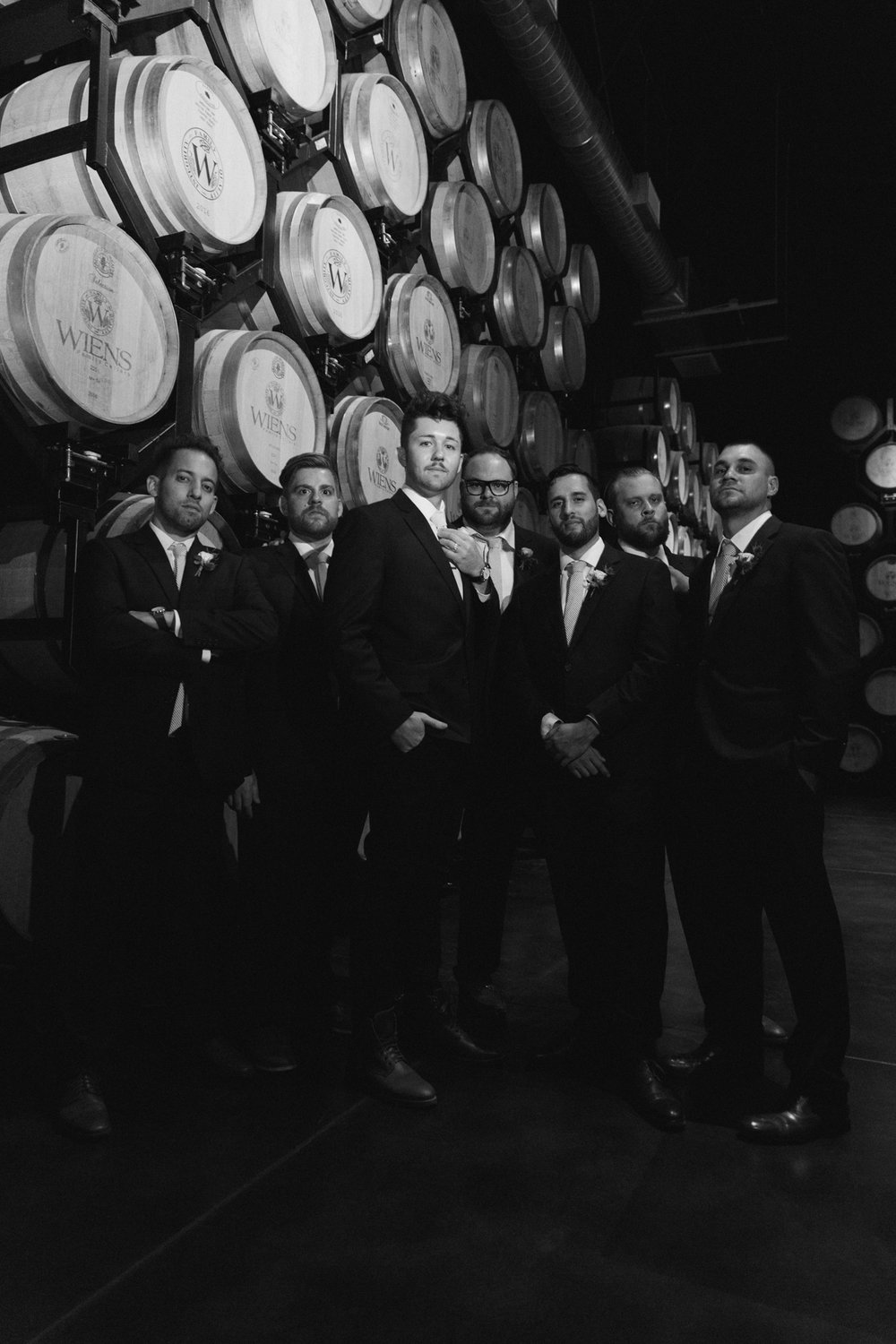 Groom and groomsmen in barrel room at Wiens Family Cellars
