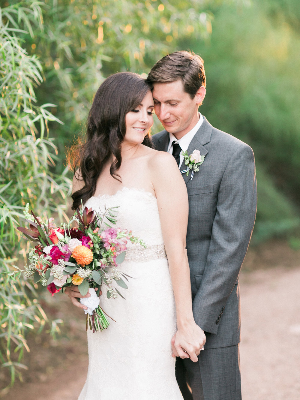 Gorgeous bride and groom portrait in gorgeous greenery and golden light captured by Phoenix wedding photographers, Betsy & John