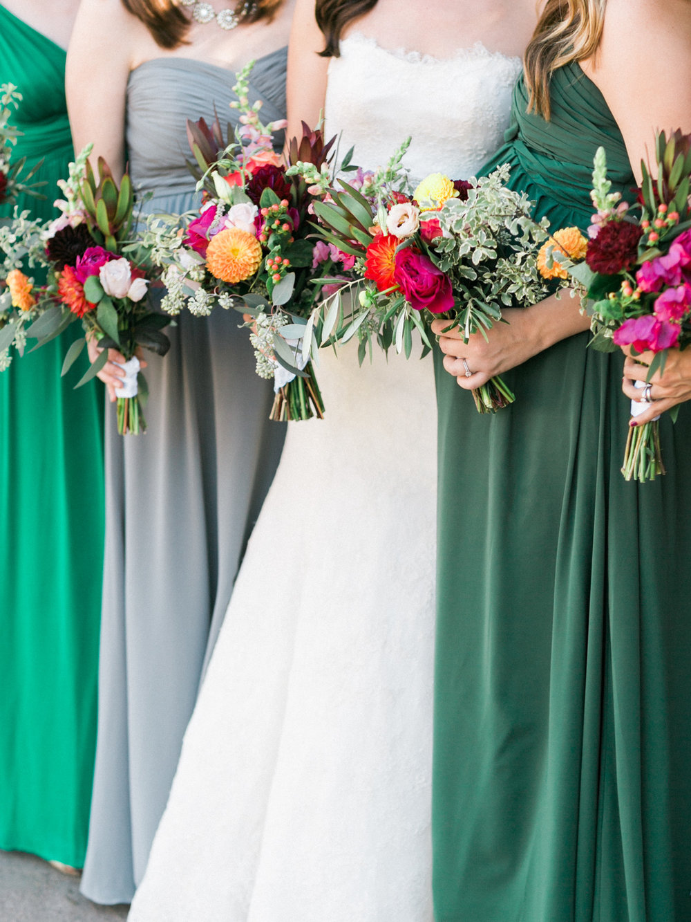 Gorgeous green, teal and gray bridesmaids dresses with jewel tone bouquets