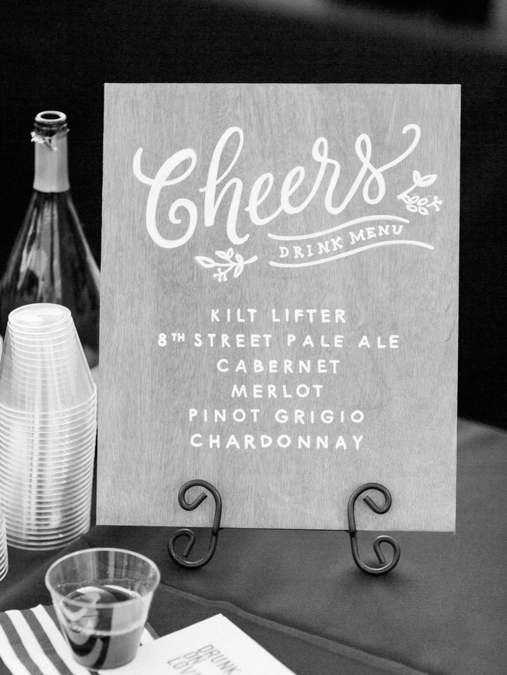 Hand lettered wood sign to display the wedding drinks at the bar. Cheers!