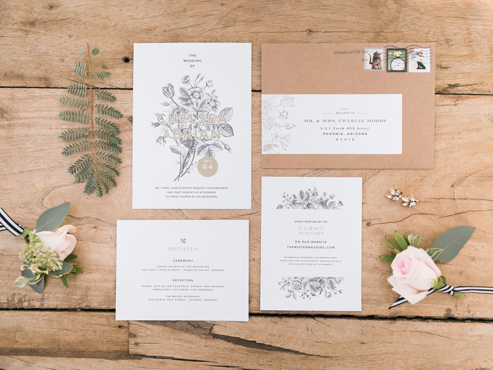 Beautiful wedding details. Invitations styled with foliage and florals