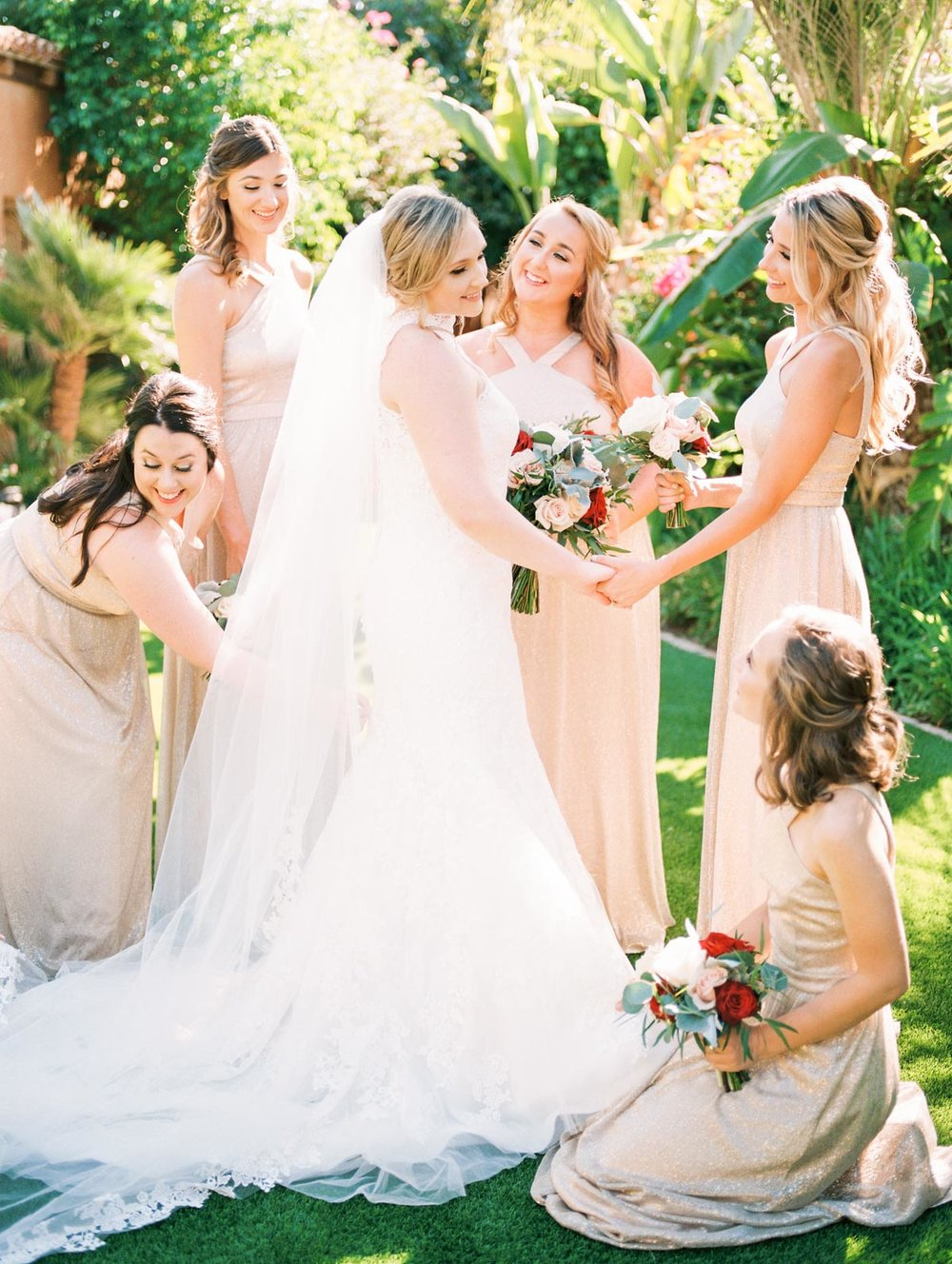 bridesmaids-helping-bride.jpg
