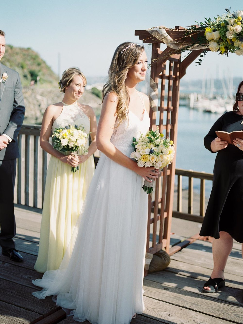 Gorgeous wedding in front of the Golden Gate Bridge at Presidio Yacht Club, captured by Bay Area Wedding Photographers Betsy & John