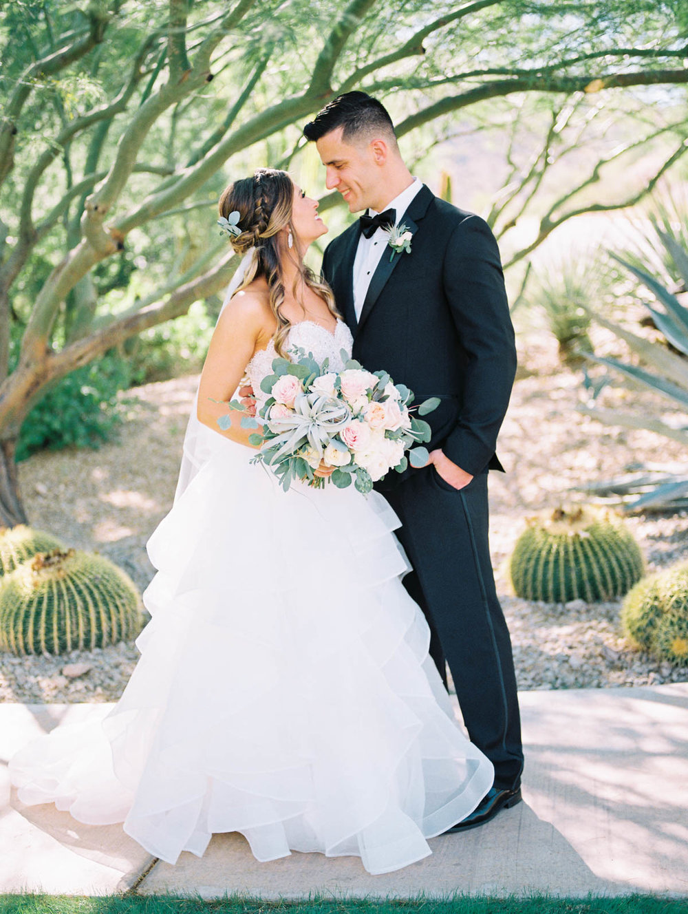 Smiling bride & groom captured by Tucson Wedding Photographers Betsy & John