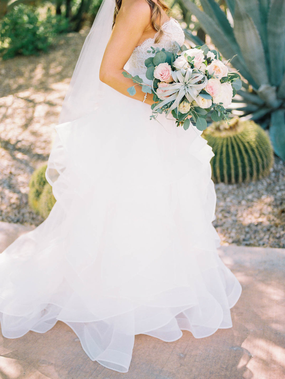 Gorgeous blush bouquet with greenery and air plants captured by Tucson Wedding Photographers Betsy & John