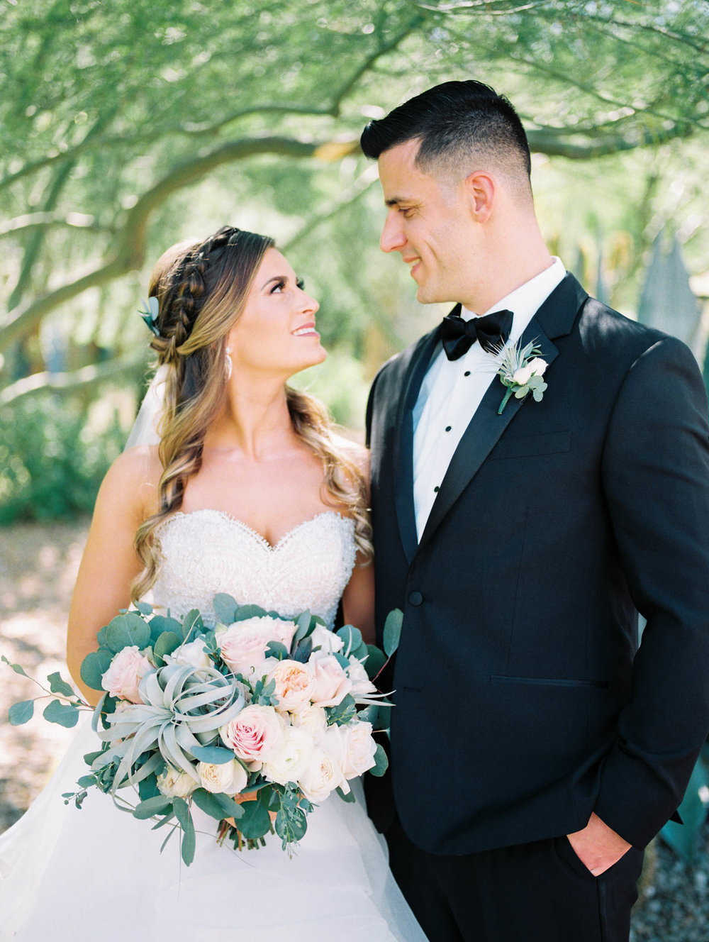 Joyful bride and groom captured by Tucson Wedding Photographers Betsy & John