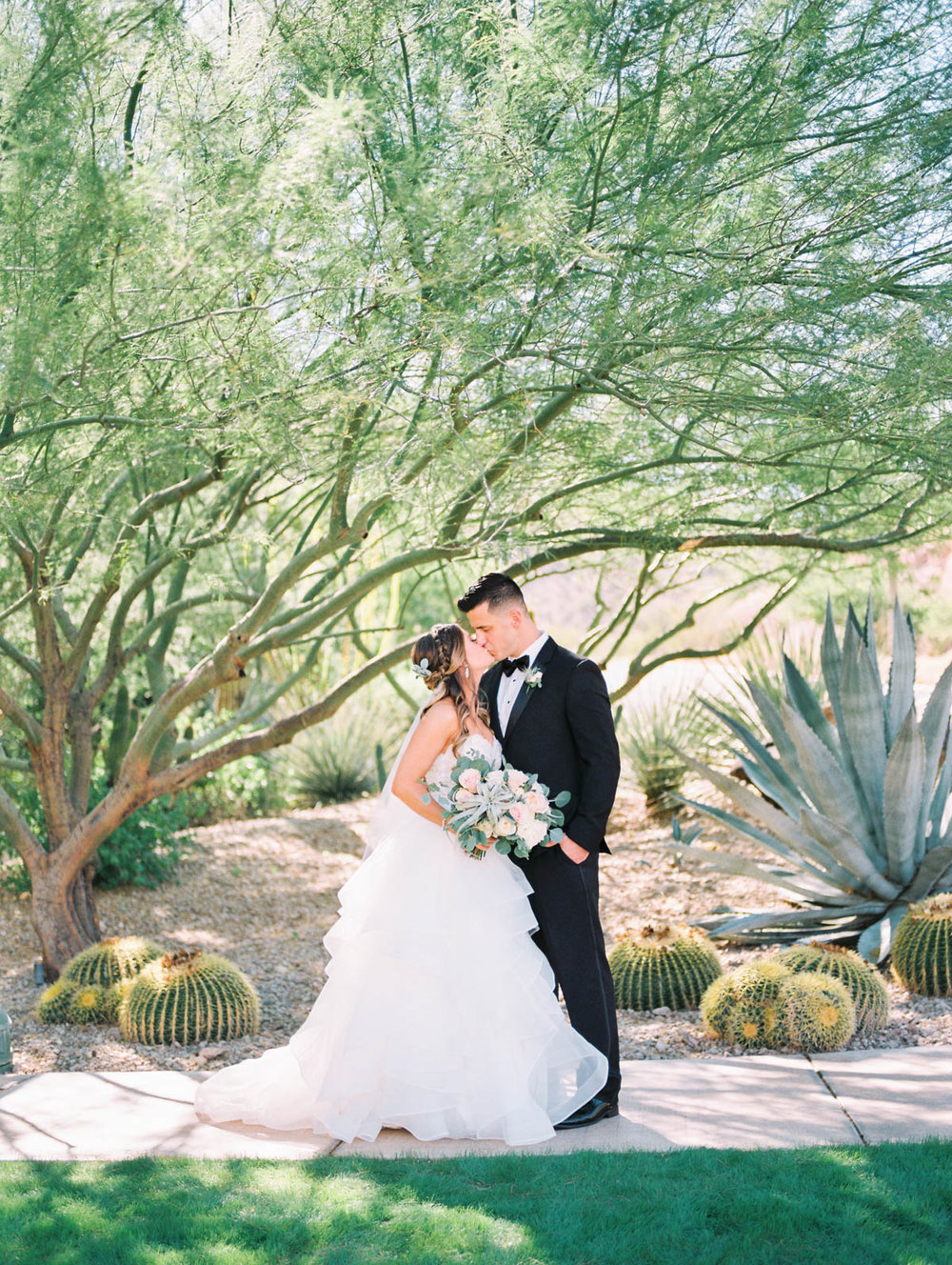 Bride & groom at JW Marriott Starr Pass captured by Tucson Wedding Photographers Betsy & John