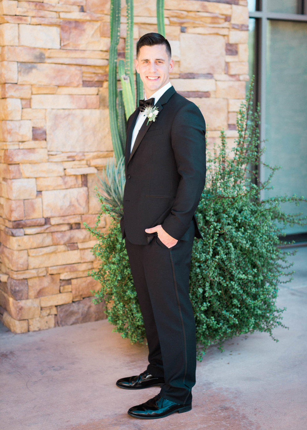 Handsome groom in black tuxedo captured by Tucson Wedding Photographers Betsy & John