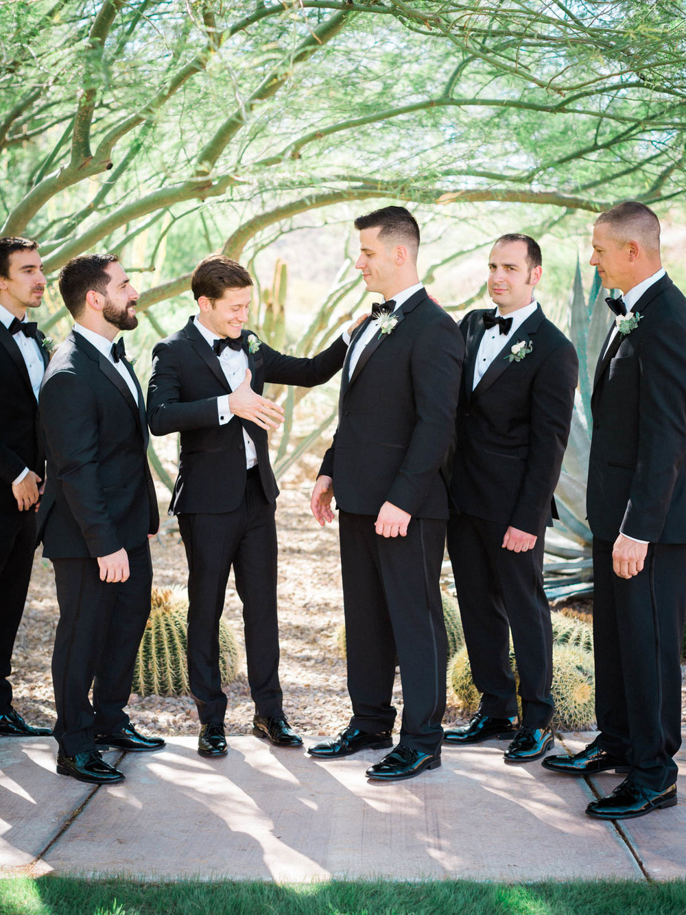 Groom with groomsmen captured by Tucson Wedding Photographers Betsy & John