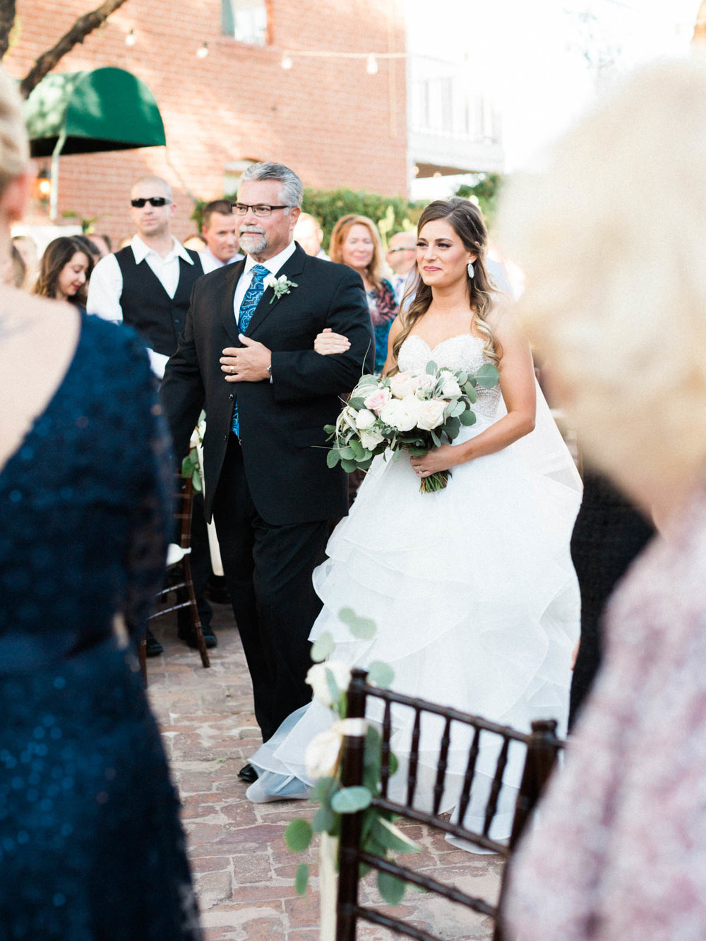 Father walking his daughter down the aisle  captured by Tucson Wedding Photographers Betsy & John