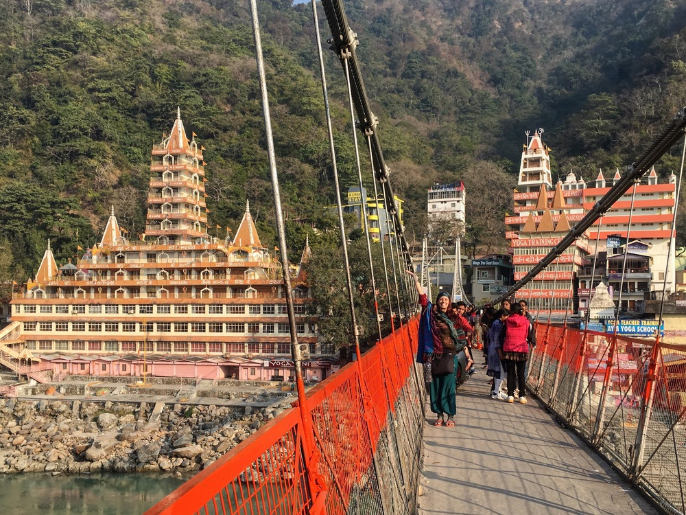 Crossing the Laxman Jhula bridge in Rishikesh, India.