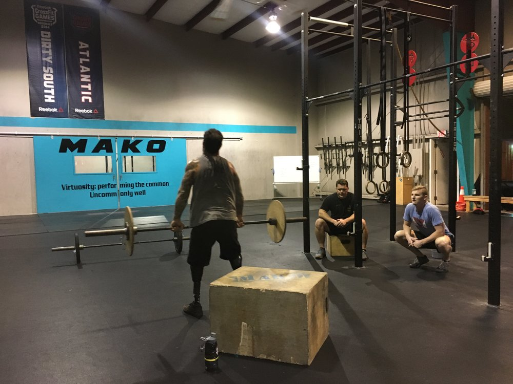 Nick doing Thrusters using a box.