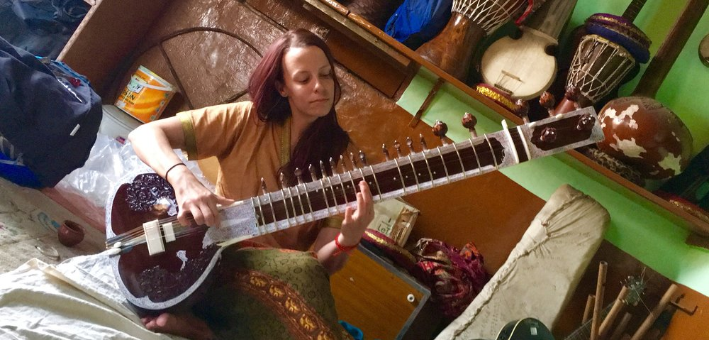 Studying sitar at the Baba School of Music in Varanasi, India. Does this sitar make me look good? Because it doesn't make me  sound  good! So difficult to play.