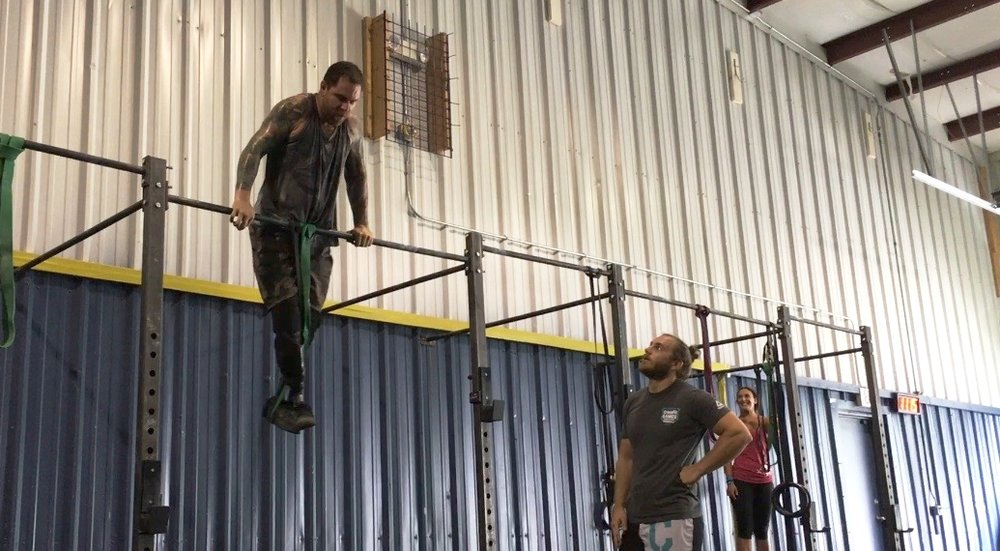 Nick getting his first bar muscle up at Crossfit 350 in Illinois.