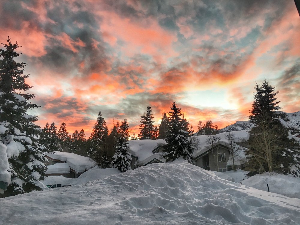 Firey sky over the snow-covered Snow Creek neighborhood in Mammoth Lakes, California.