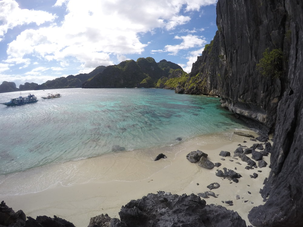 Turquoise waters, limestone cliffs, quiet.