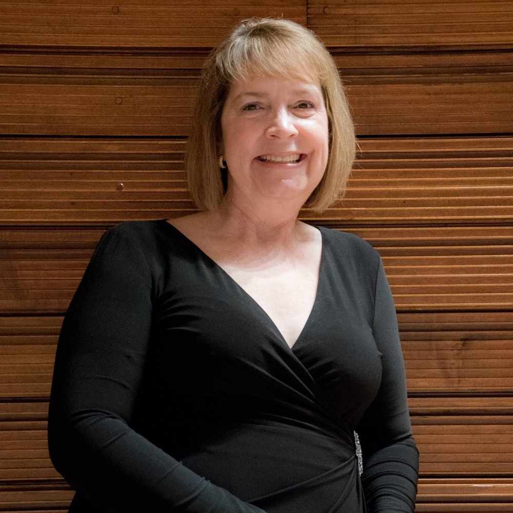 Kimberlie Richter, Co-Music Director of the Naperville Youth Symphony Orchestra (NYSO)