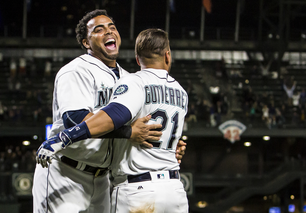 Nelson Cruz and Franklin Gutierrez celebrate after teammate Leonys Martin hit a walk off two run homer in the ninth inning of the Mariners' 6-5 win over the Oakland Athletics at Safeco Field in Seattle, Wash. on May 24, 2016. (Lacey Young, seattlepi.com)