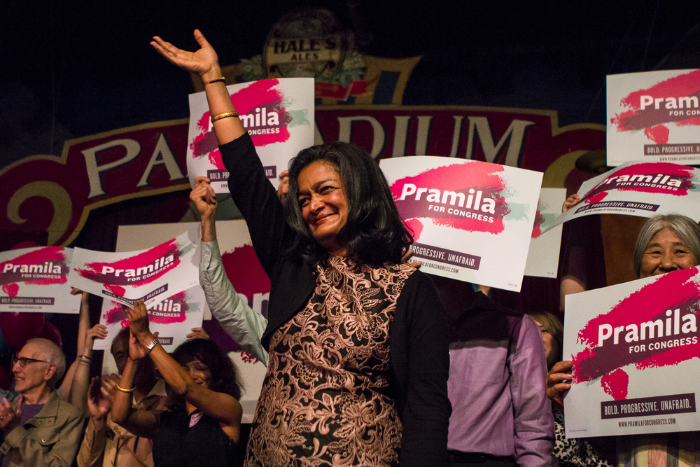 Seventh Congressional District senate candidate Pramila Jayapal waves to her supporters as she finishes her celebratory speech at Hale's Palladium in Ballard, Wash. on Aug. 2, 2016. (Lacey Young, seattlepi.com)