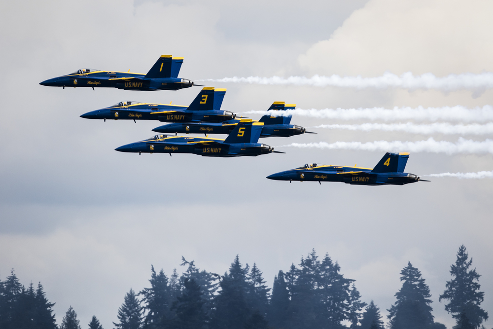The U.S. Navy Blue Angels pass in formation over the horizon during their final performance of Seafair weekend over Lake Washington in Seattle, Wash. on Aug. 7, 2016. (Lacey Young, seattlepi.com)