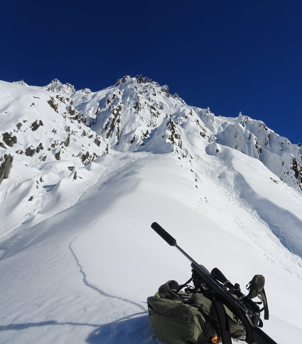 Steep snowy terrain, baking in the sun.