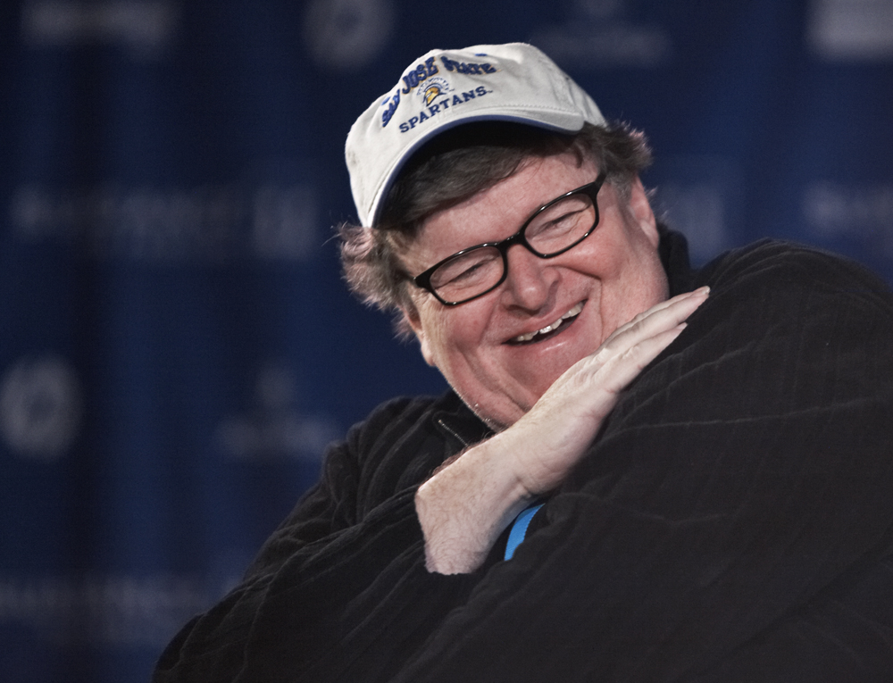 Filmmaker Michael Moore takes the stage during  the Film Movement Panel at Filmmaker's Lodge.