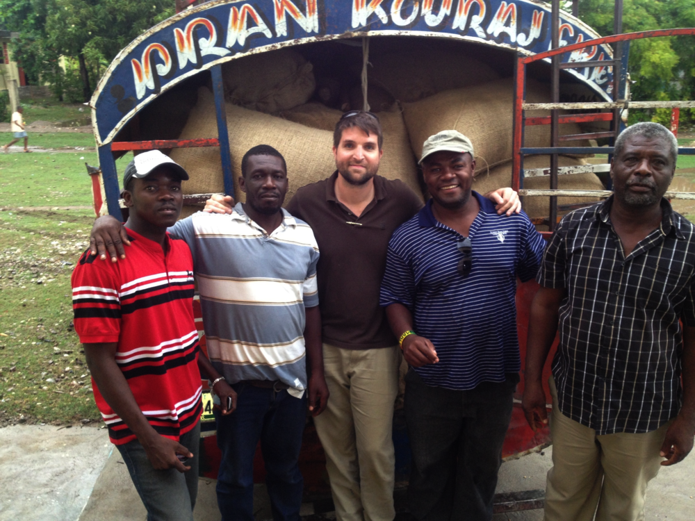 Casey with Haitian coffee growers after purchasing coffee. This project was funded by DHS Development.