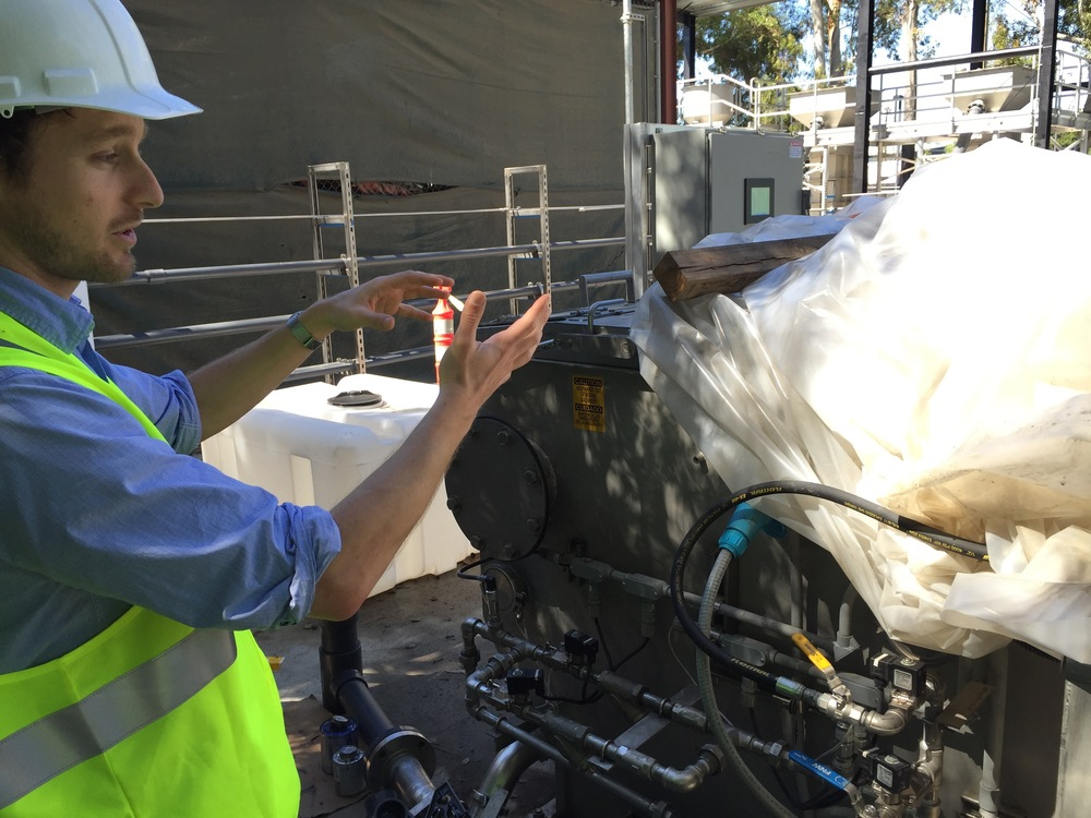 CR2C Director of Operations, Dr. Sebastien Tilmans shows how it works. Stage 2) Primary treatment process uses a microscreen to remove solids from the water and dewater them to up to 50% solids. The machine is currently configured to send the solids in a slurry back to the sewer.