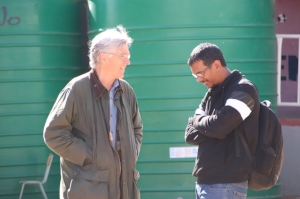 Karl w/ Igshaan Samuels with water tanks in background