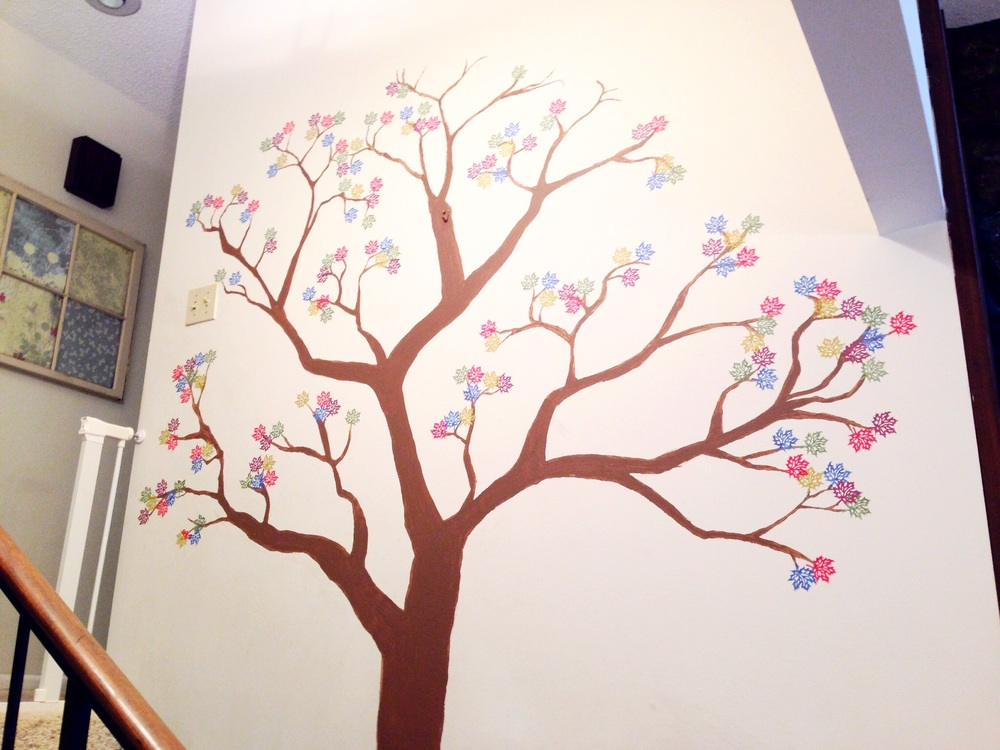 Our family tree in progress. My artist husband free-handed the tree...