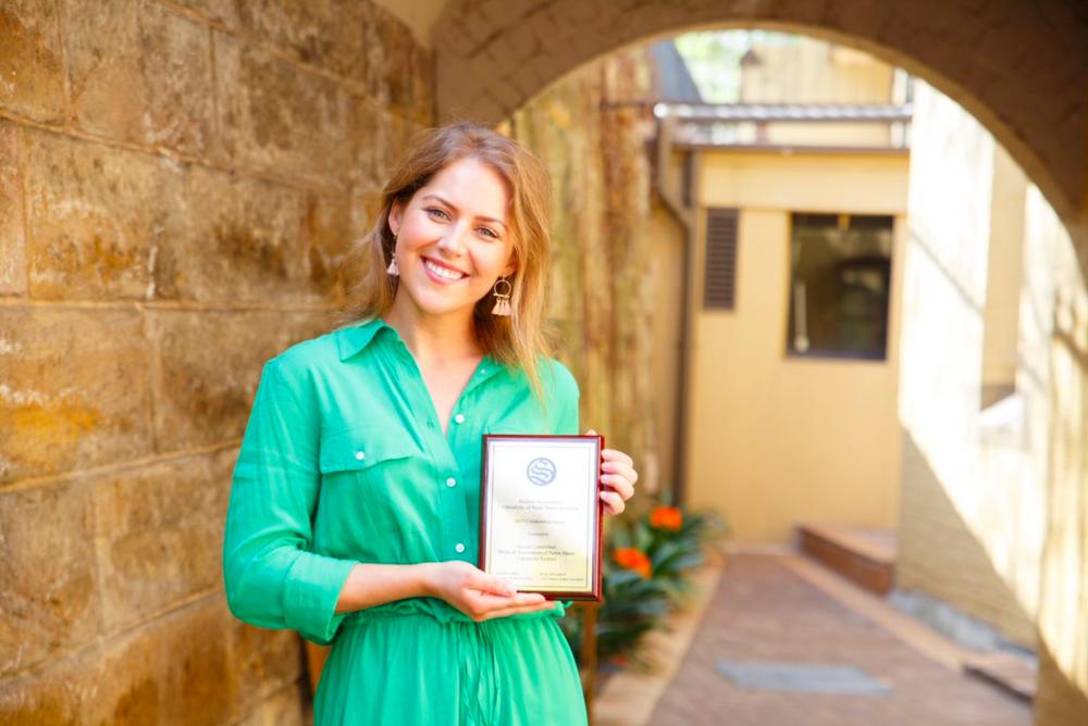 Antonia Watson, MANDUS Social Representative,accepting the Collaboration Award on behalf of MANDUS.