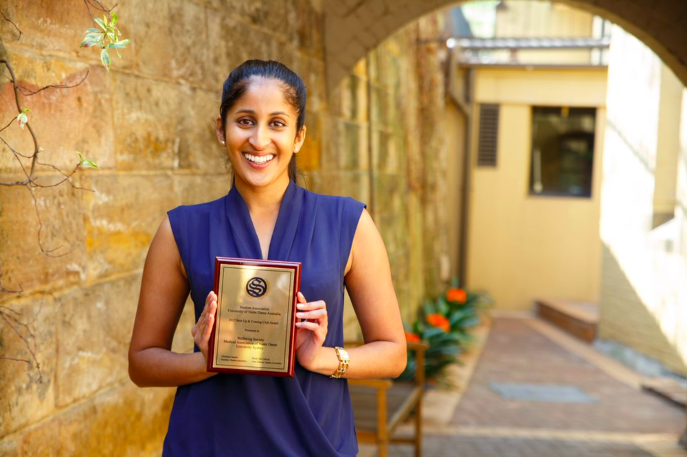 Nikita Naidu accepting the Best Up & Coming Award on behalf of the Wellbeing Society - MANDUS.