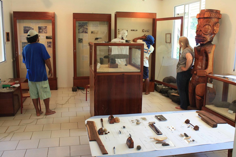 "2013. Mounting the ""treasures of Tahuata"" exhibit. In action: Manuhi Timau,Samuel Tiaiho, Hio Timau and Maryjane Sherwin."