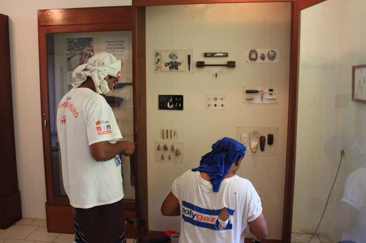 "2013. Samuel Tiaiho and Hio Timau mounting the ""Treasures of Tahuata"" exhibit."