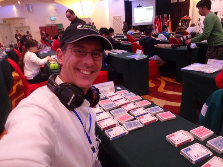 Preparing to memorize 14 decks of shuffled playing cards. China, World Memory Championships 2014.