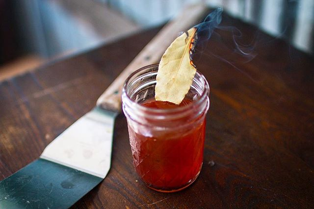 Is it the weekend yet?! Ready to sip on this cocktail with some ribs🔥 •BBQ Old Fashioned w/ Burnt Bay Leaf• 2oz Rye  1 Barspoon Bay Leaf Infused molasses  3 Dashes Peychauds Bitters Smoking Bay Leaf to garnish  #cocktailacademy #bbqseason #smokeddrinks #grillmaster