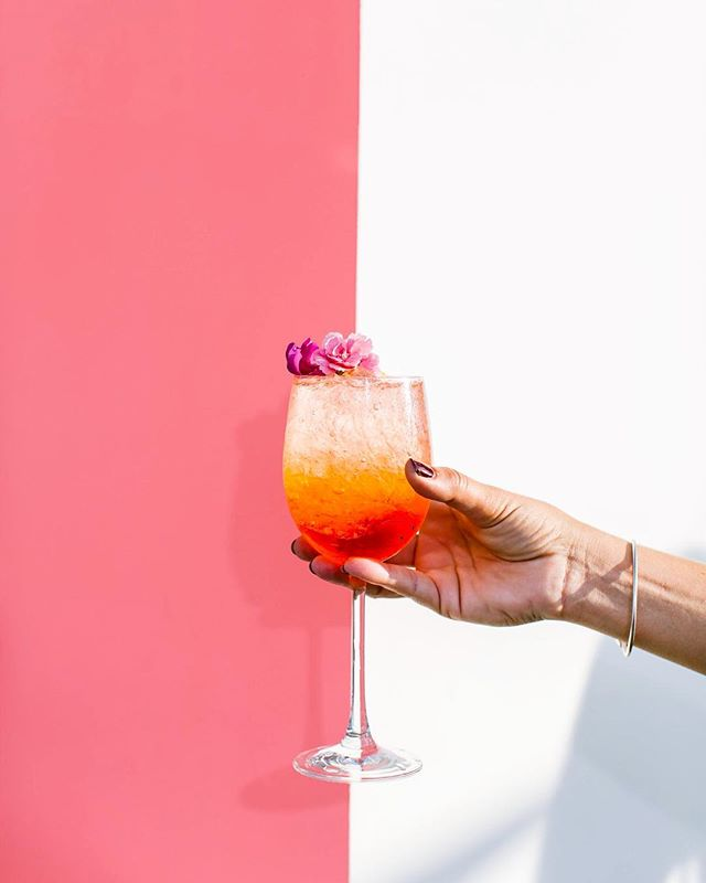What's your good luck charm on Friday the 13th? Ours is definitely this spritz🌺pour us another please! •Aperol Sprtiz• 2oz Aperol  3oz Prosecco  Splash Club Soda  Crushed Ice  Edible Flower for Garnish 📷: @lexgallegos for @honest_beauty launch💋 #cocktailacademy #aperolspritz #summerofthespritz #aperol
