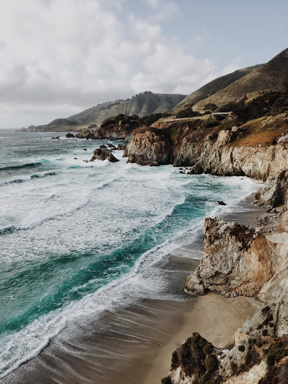 Greenish blue waters and wild waves hitting out at the rocky heights...this is Big Sur for you!
