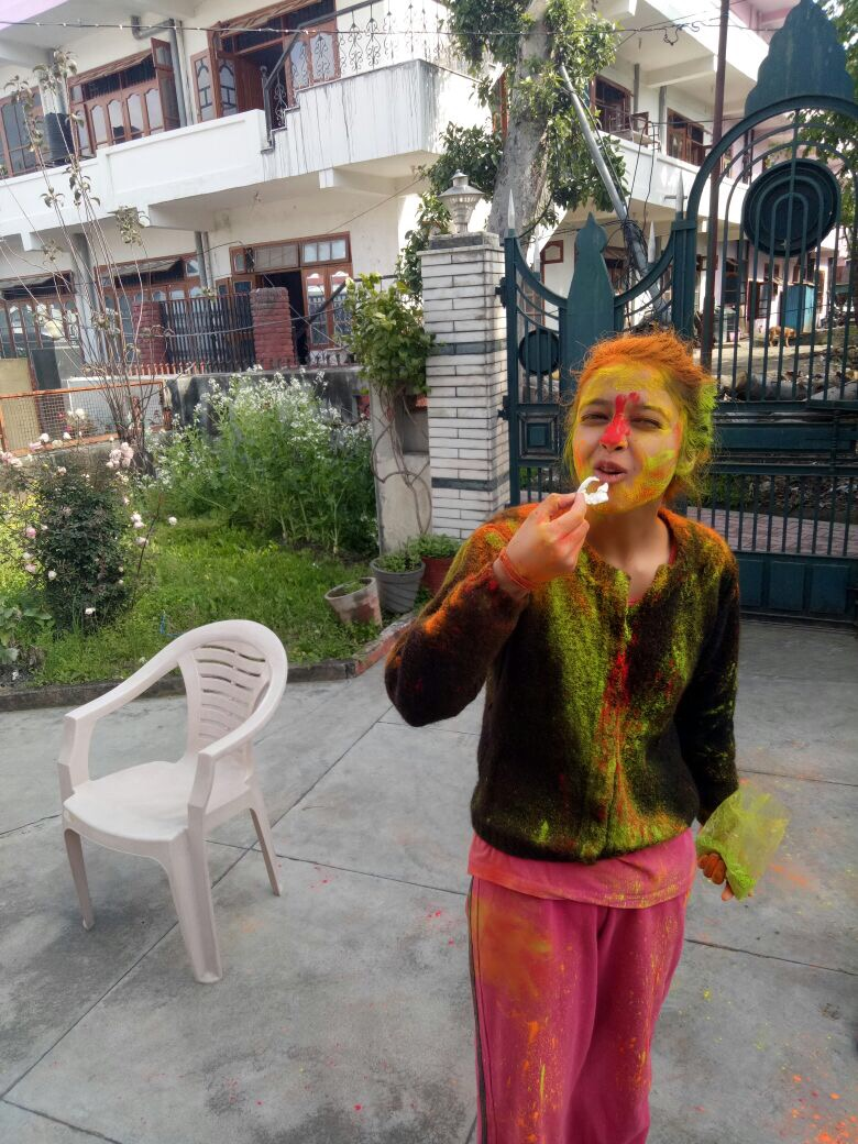 Enjyong a sweet on Holi