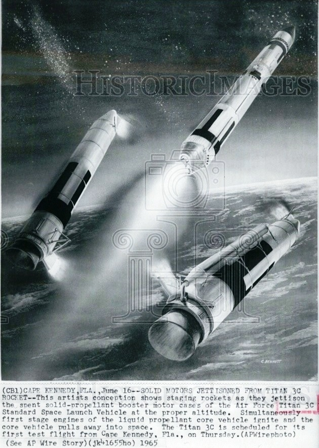 Jacobe's image was probably modeled after this 1965 press release image illustrating the manner in which the expended United Technology Center solid fueled boosters detach from the Martin-Marietta Titan core stage.
