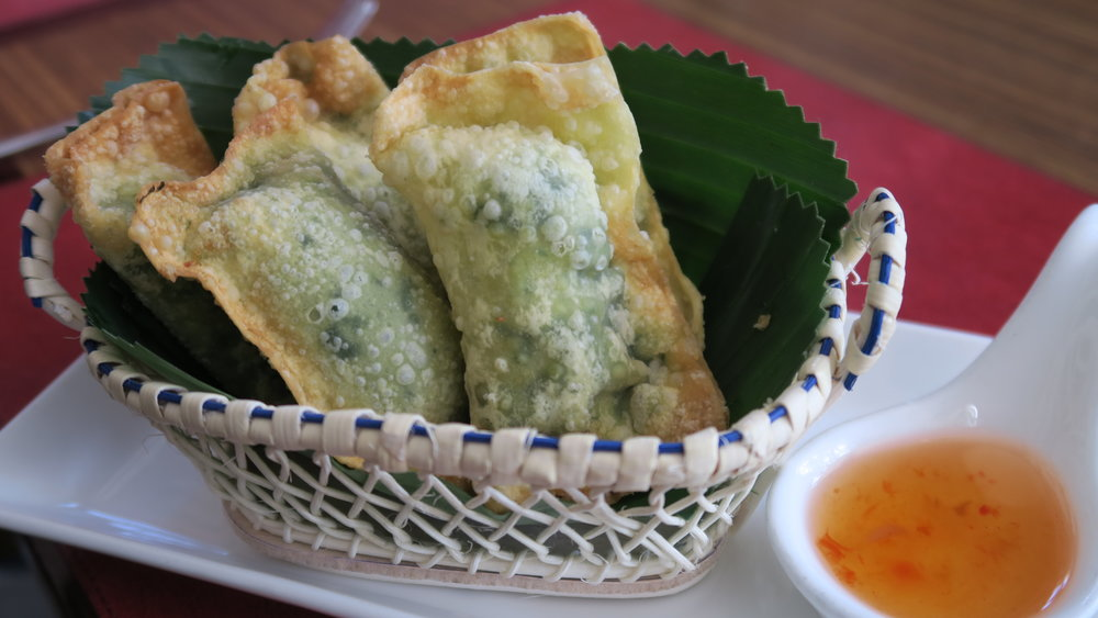 Kio Hor Cheese  - Deep-fried wonton wrapped in mozarella and spinach, served with  plum sauce