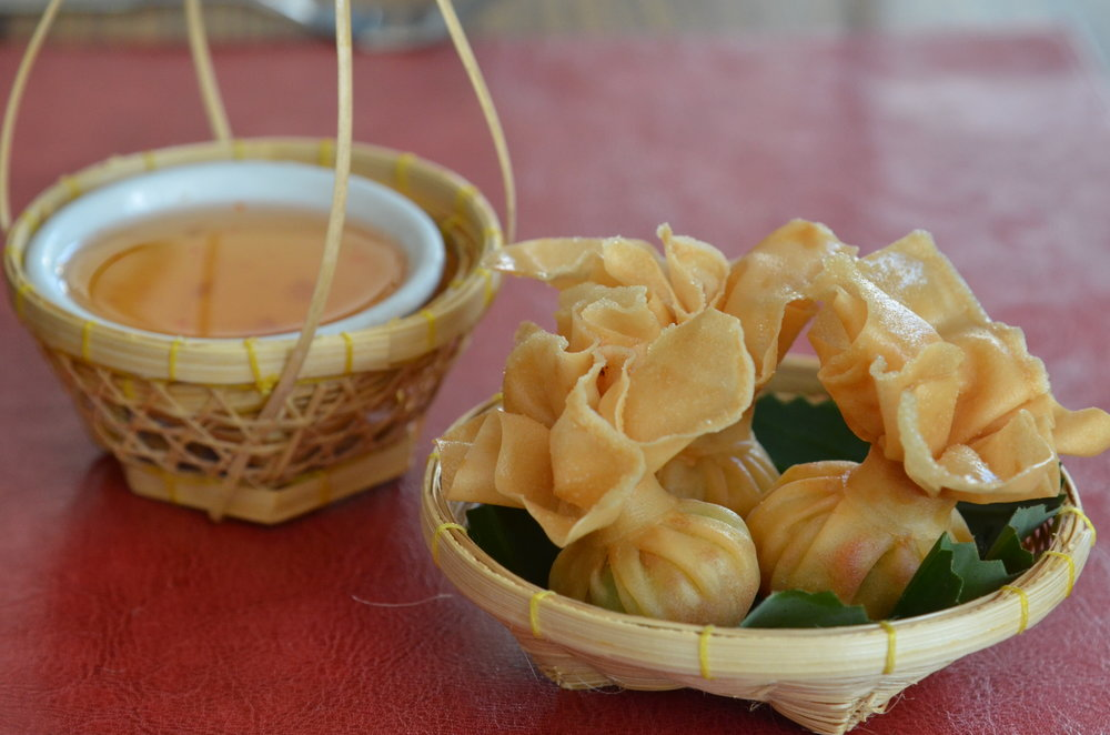 Money Bag  - Crispy fried mixture of minced chicken, prawn and sweet corn wrapped in rice pastry, served with plum sauce