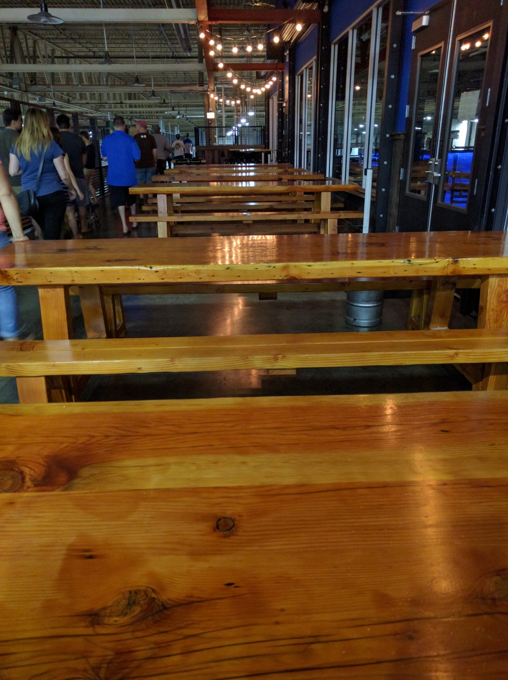 They bought equipment that was too big for their California location and had to cut the roof and make it taller so they re-purposed all the lumber they took off and made it into tables for the Chicago location