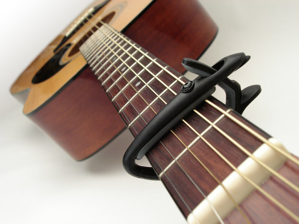IH16-capo on guitar-1024x768.jpg