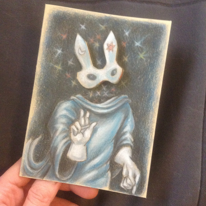 The finished color pencil drawing of the Invisible Ghost Bunny with his mask on.