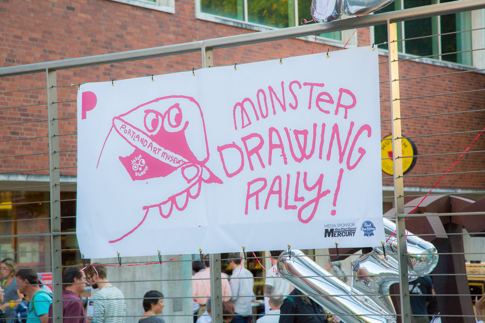 The Monster Drawing Rally sign at the Portland Art Museum.