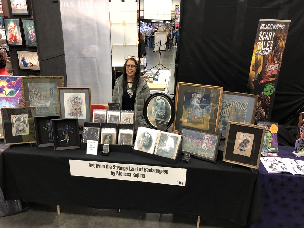 Melissa Kojima in front of her artist's alley table at Wizard World Comic Convention in February 2019.