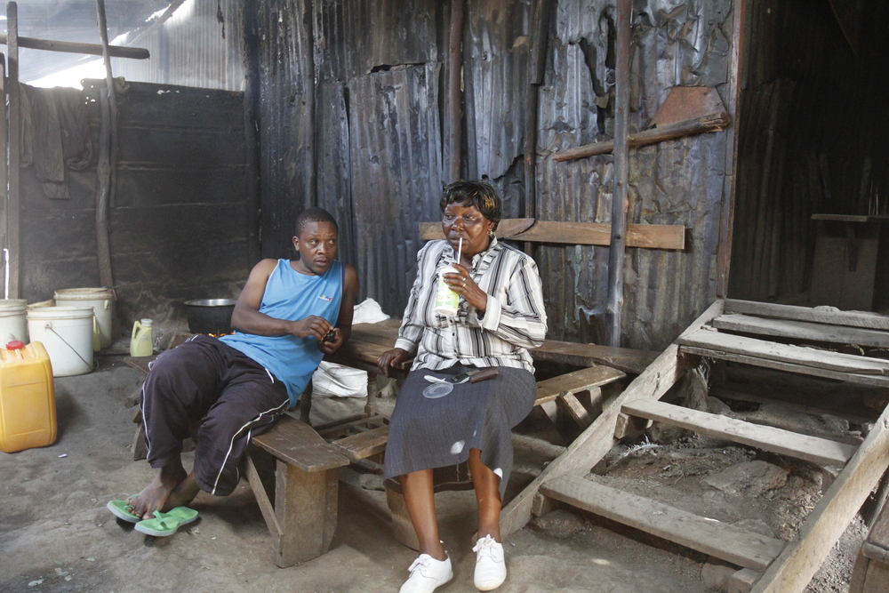 Rosemary with her son Onyango at her bar