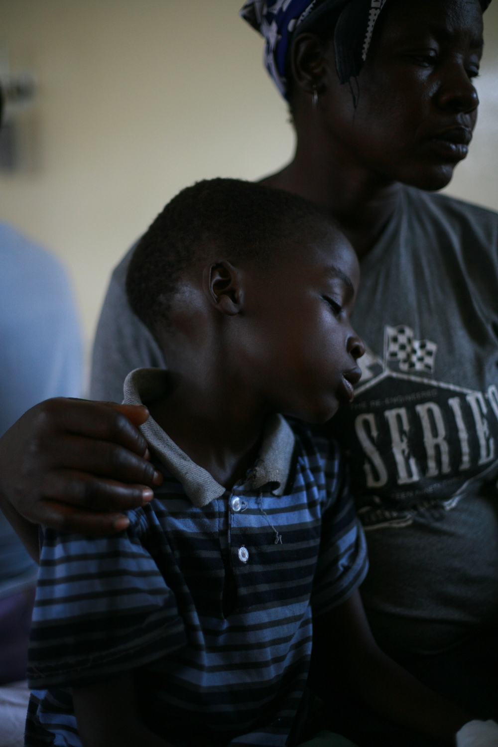 A child in the in ward 8(Acute ward- emergency room) rests on his mother after being relived of pain..JPG